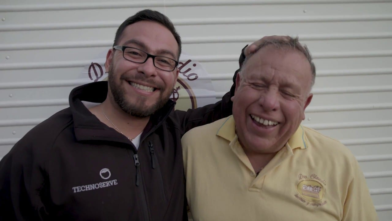Two men smiling together in Chile