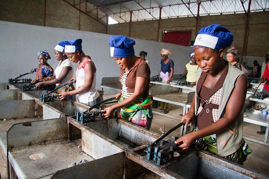 Workers at cashew factory in Côte d' Ivoire shelling cashew nuts