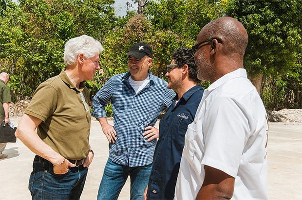 Bill Clinton talking with TechnoServe workers