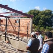 Men working on building a new brick building