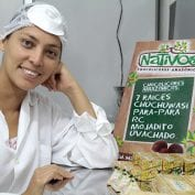 Woman smiling while processing food