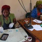 Two women working on jewelry