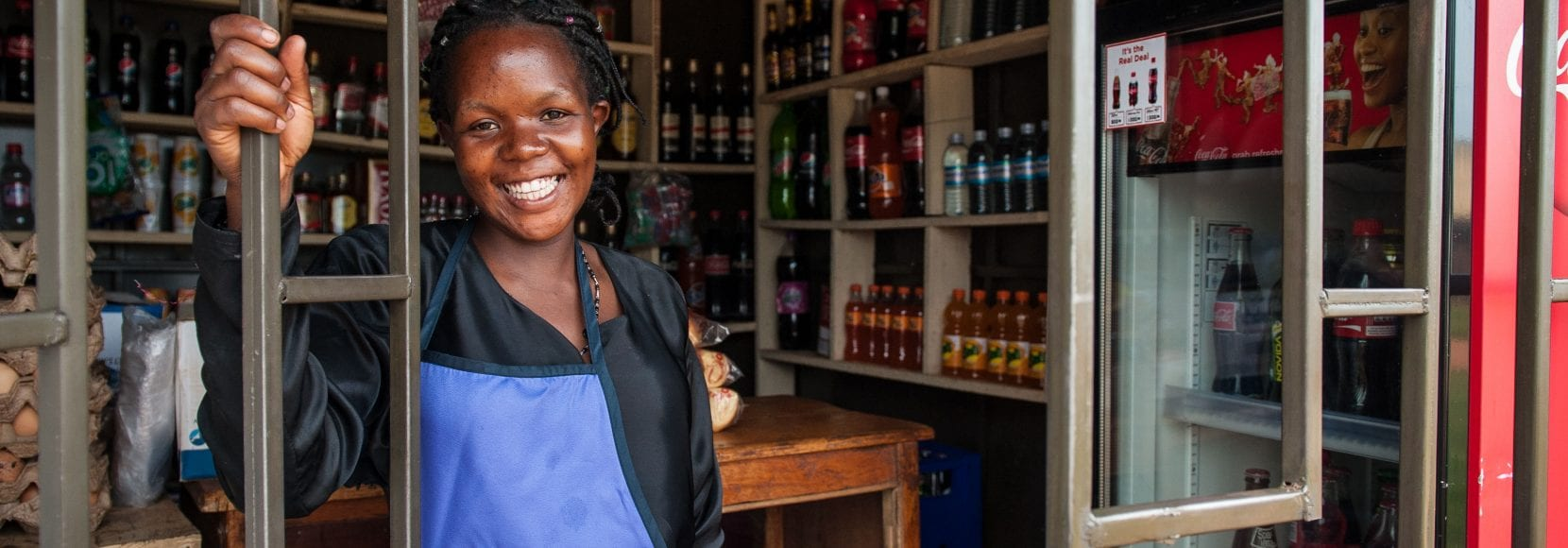 Woman smiling in her store in Uganda