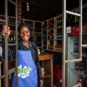 Woman smiling in her store in Uganda