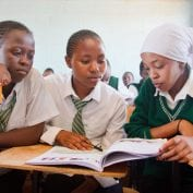 Group of young school girls studying in class