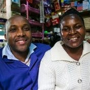 Couple smiling together in their store