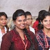 Woman smiling with Mumbai youth