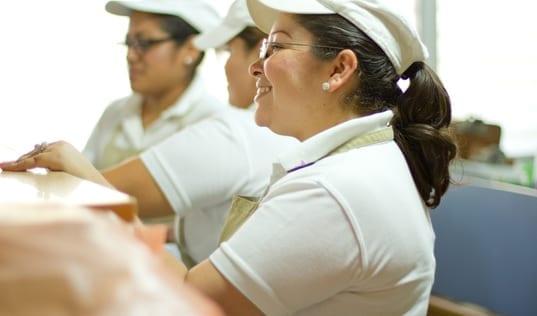 Female workers sitting in at the Central America Entrepreneurship program