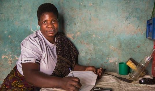 Tanzanian women with her successful mobile saving strategies