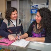 Two women smiling working together to build their business in Chile