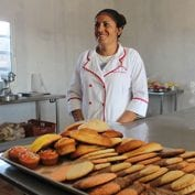 Woman working with cooked bread