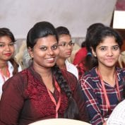 Smiling women at conference in India