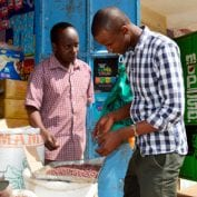 Two men in Kenya working at a store