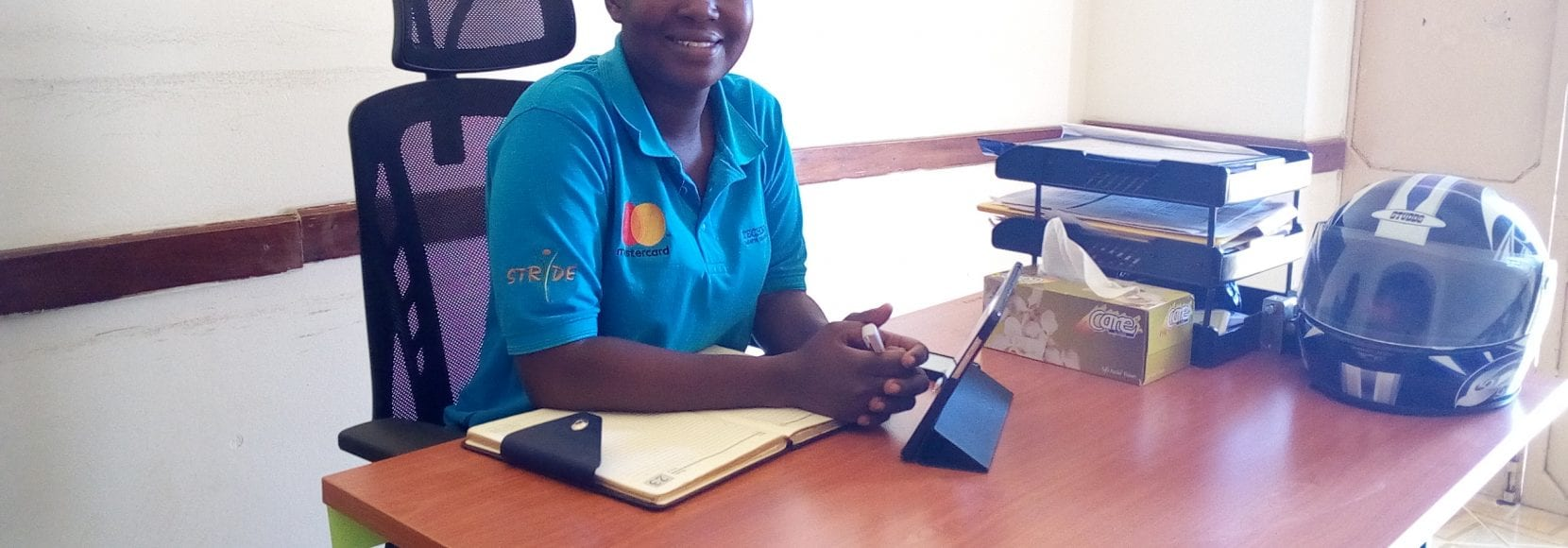 Smiling business woman in Uganda