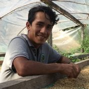 Wilmer in peru drying coffee beans