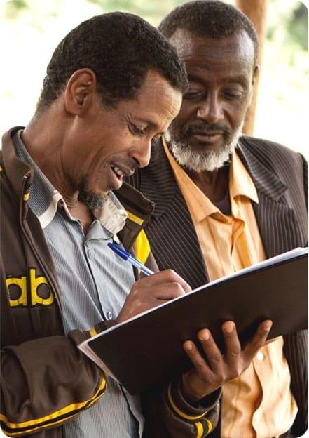 Two men working on financials