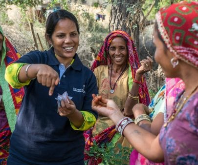 TechnoServe staff member provides field training to a group of women who are a part of Technoserve's kitchen garden program in India