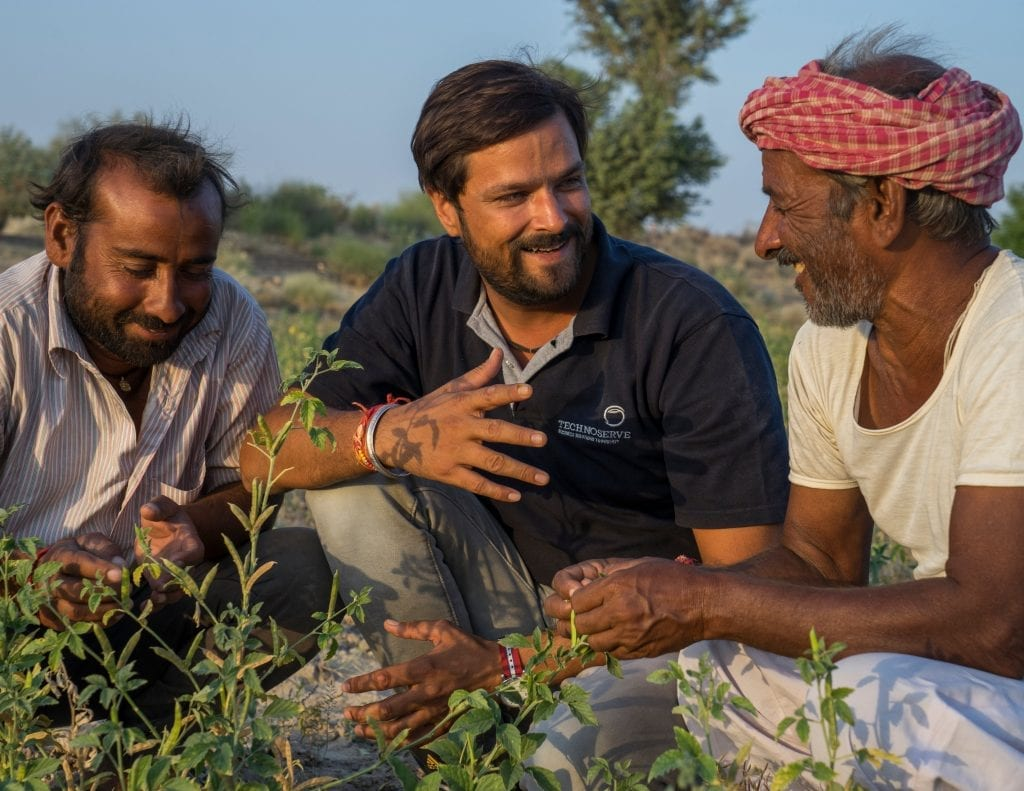 TechnoServe project manager discusses plant diseases with farmers in India