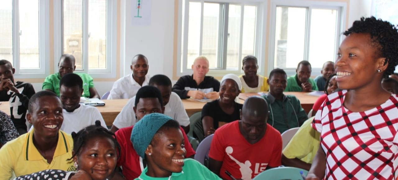 Group of people in classroom smiling