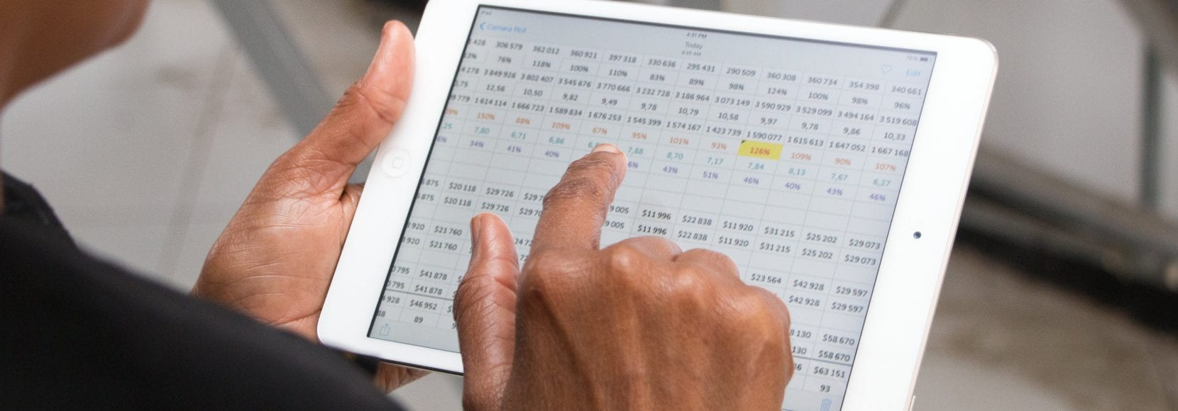 Tanzanian woman uses tablet at food processing business