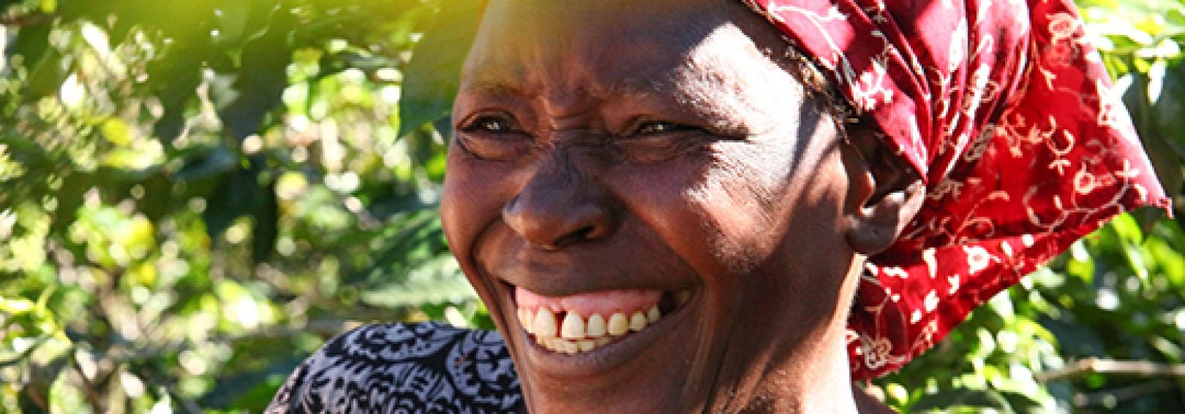 Woman smiling while working in Zimbabwe