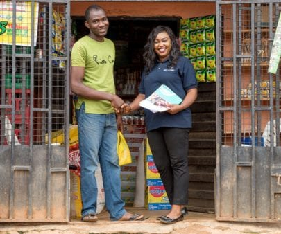 entrepreneur and TechnoServe business adviser from Mom and Pop Shops project in Nigeria