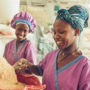 Two women smiling while working in Africa
