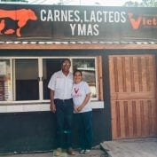 Couple standing in front of their store in Honduras