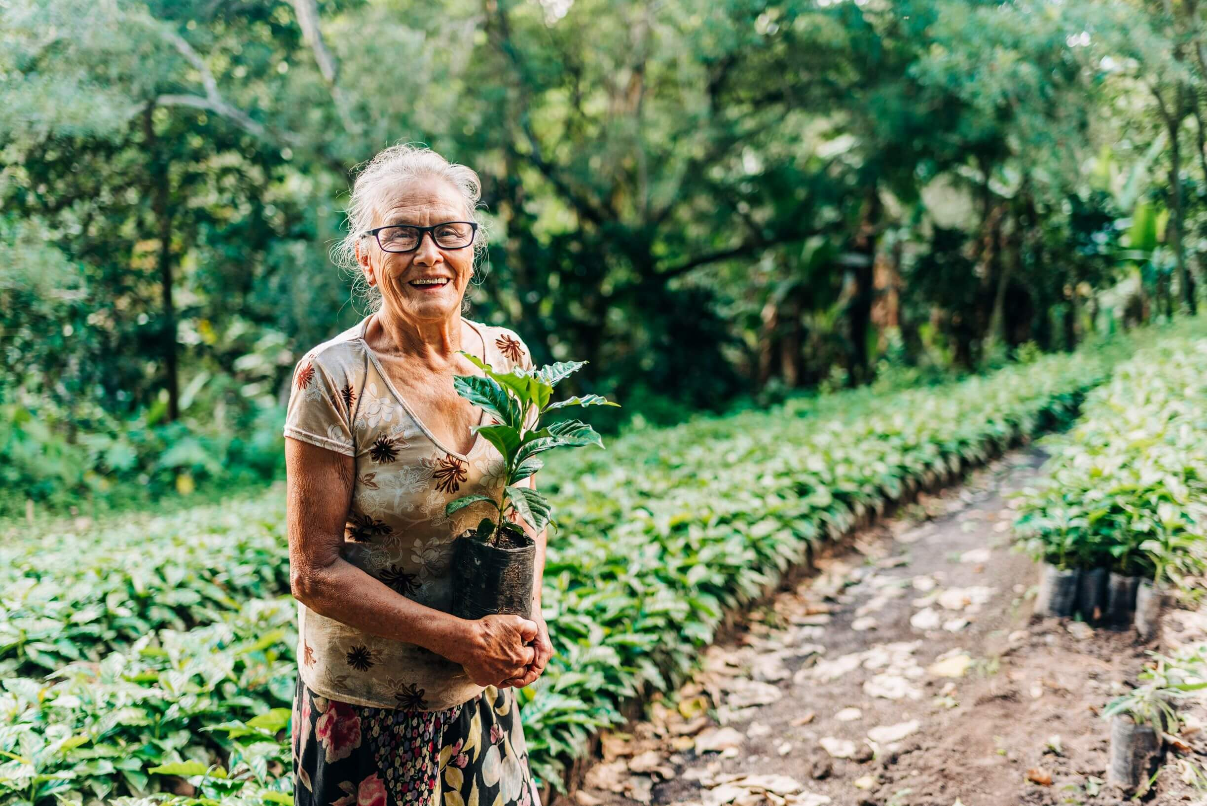 woman farmer stands near her fields in Nicaragua