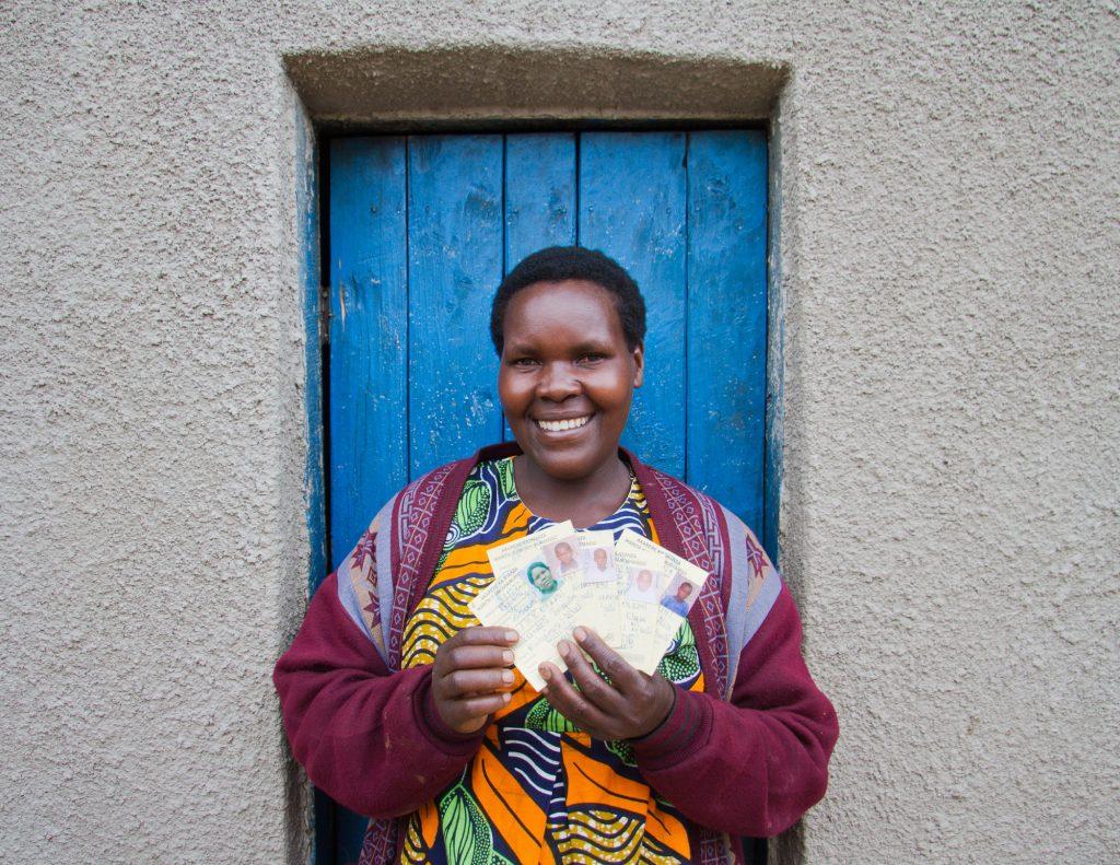 "Jackeline Mukandori with ""enhanced"" health care cards for her family, Mizero cooperative, Coffee Initiative, Nyanza district, Rwanda. Photo © 2011 Nile Sprague"