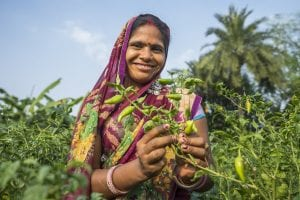 woman farmer in India shows her harvest