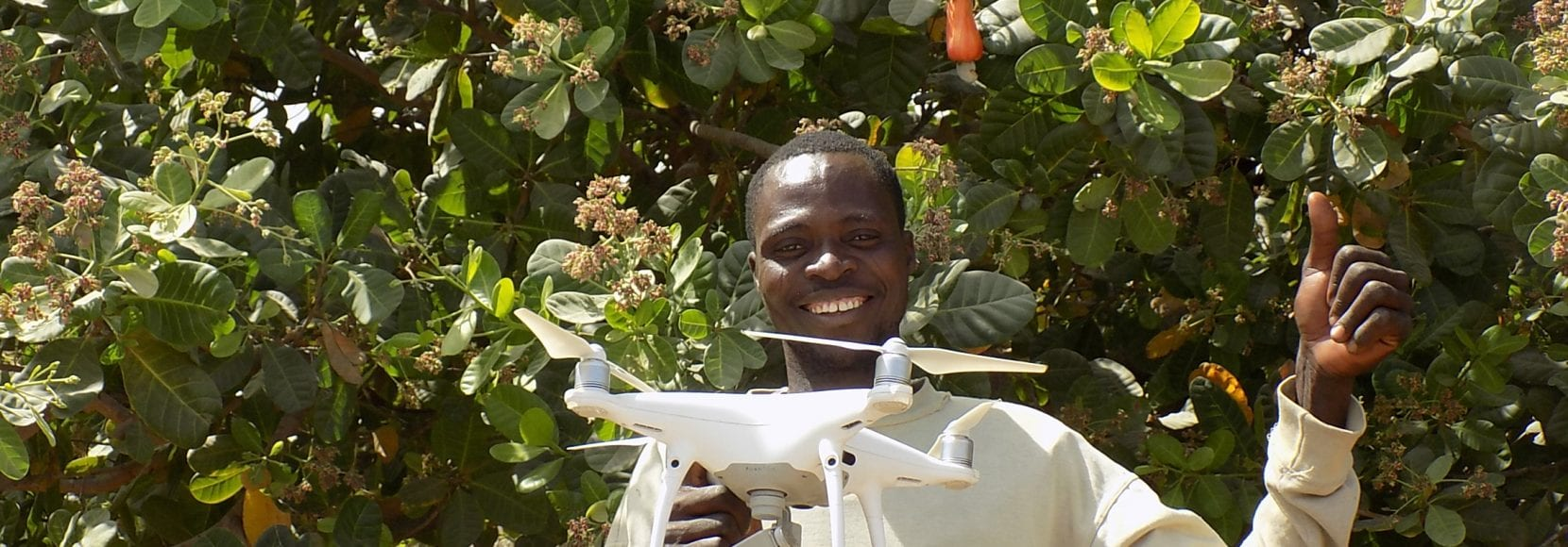 Man smiling holding drone