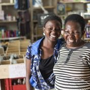 Two smiling women in grocery store in Uganda