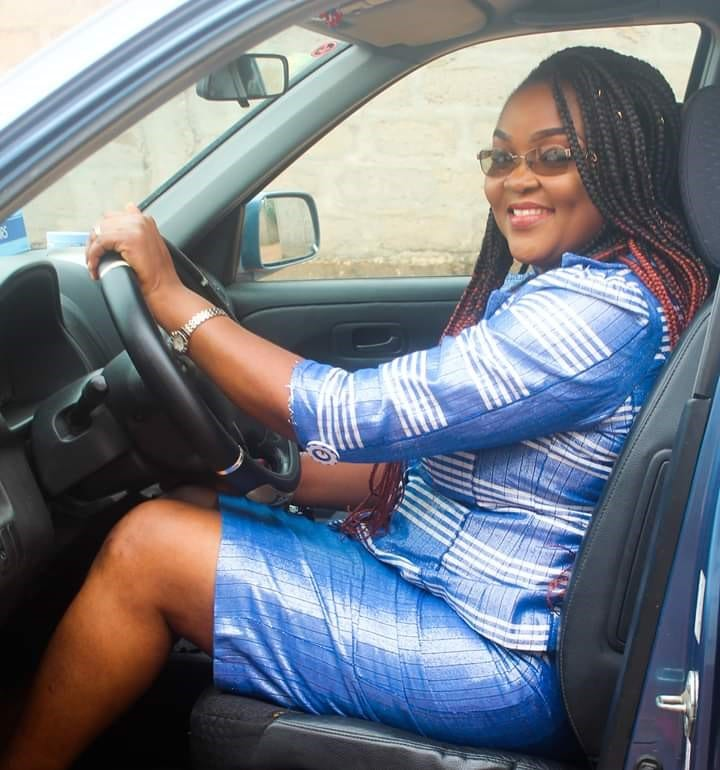 Ella drives to the TechnoServe office in Benin