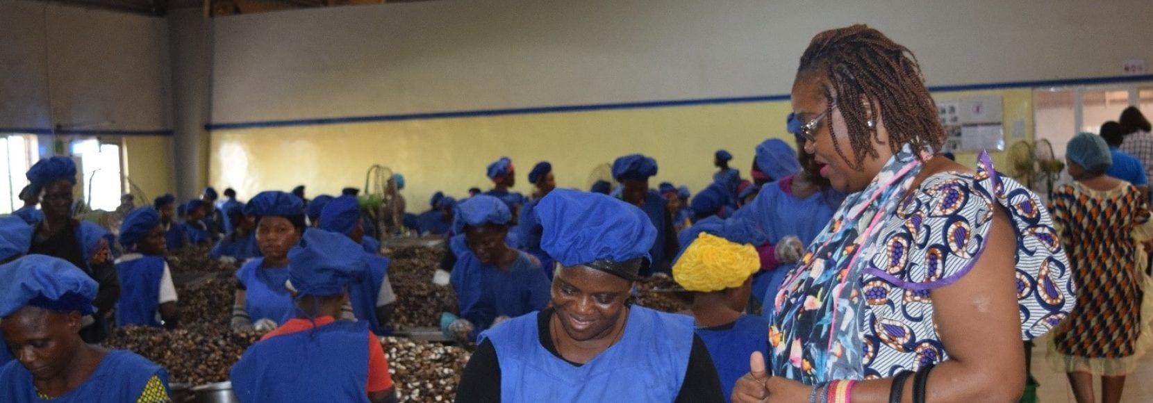 Ella Wama at a cashew factory in Benin