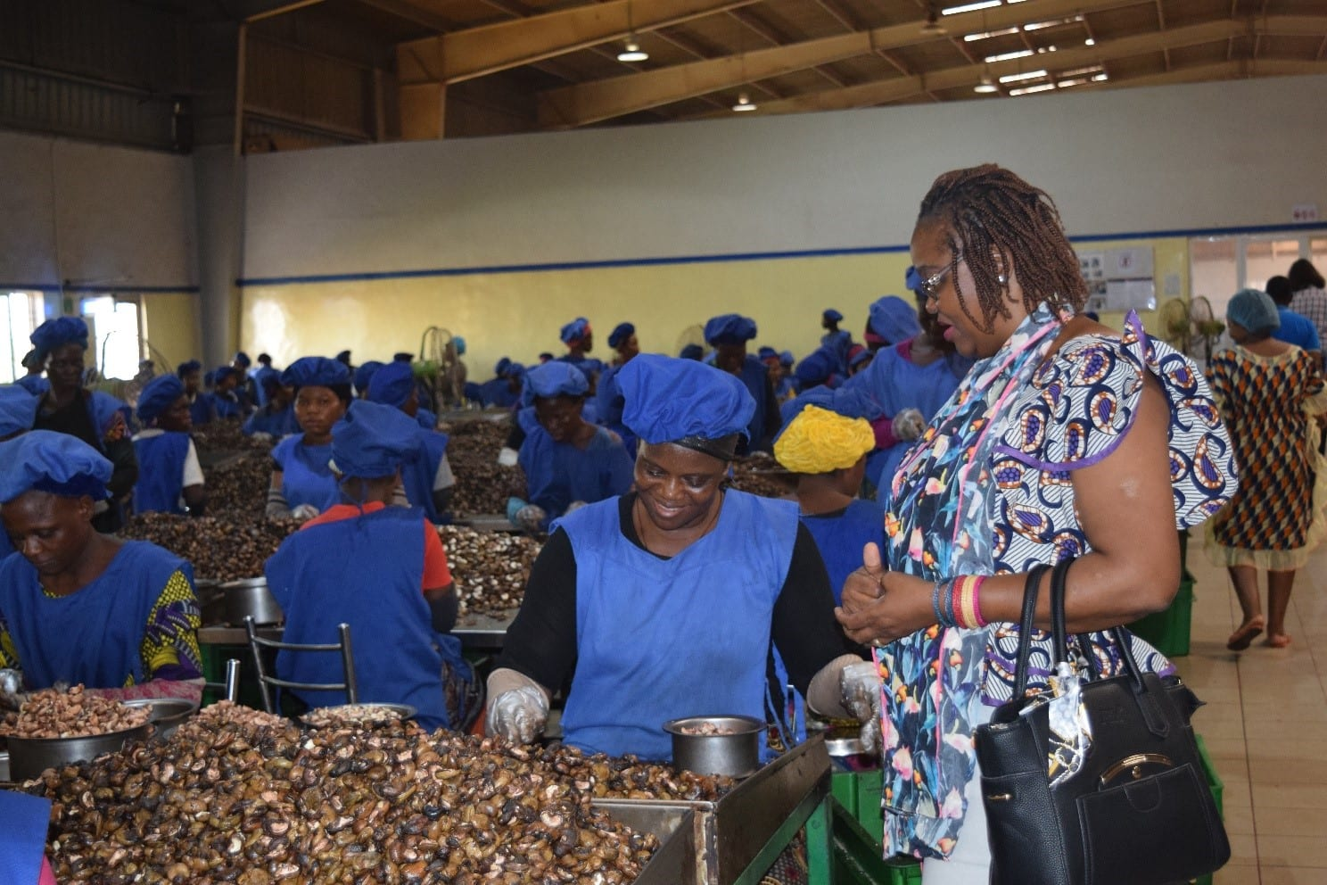 Ella Wama at a cashew factory in Benin