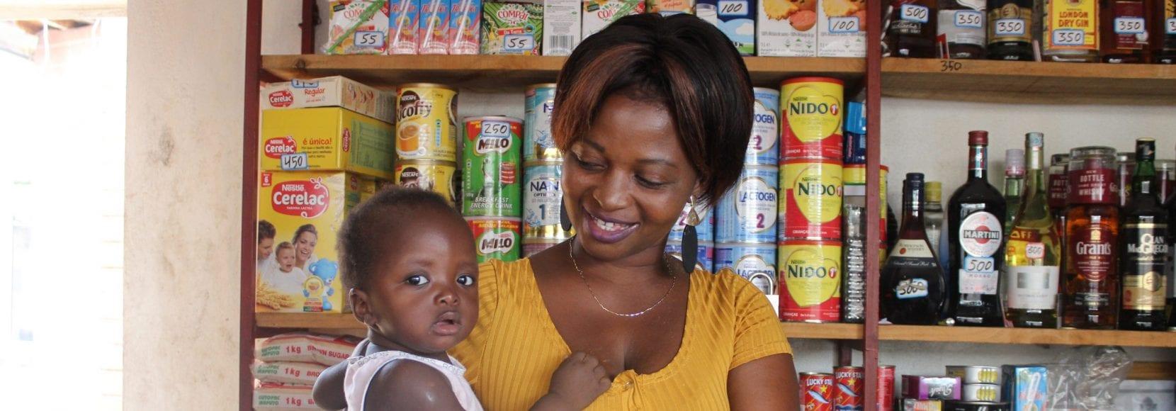 Bernadette Sambo stands in her shop in Mozambique.