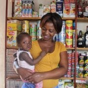 Bernadette Sambo stands in her shop in Mozambique.