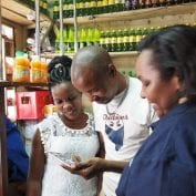 At TechnoServe, we're committed to fighting poverty to help people like this shopkeeper in Kenya