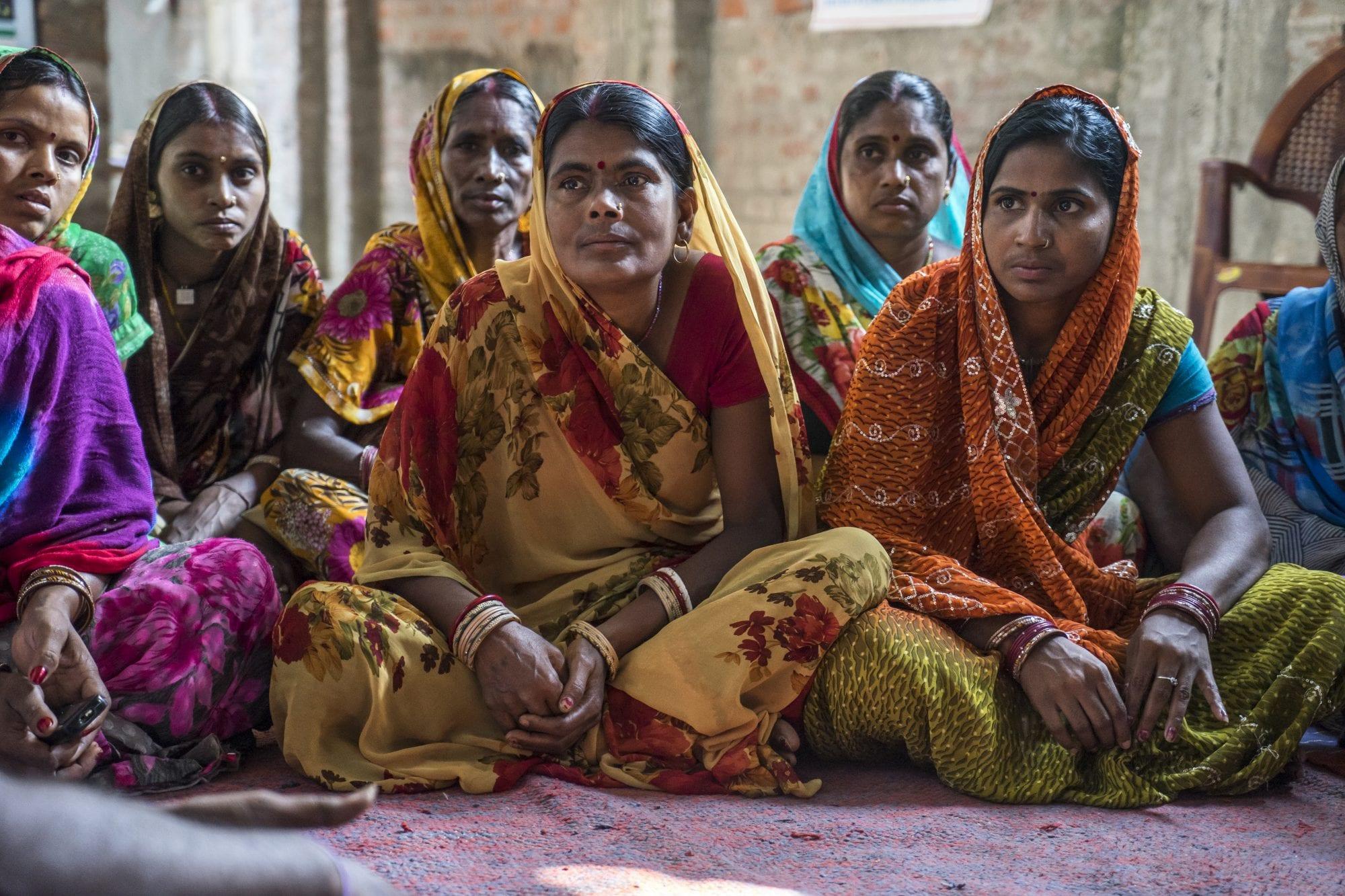 Women vegetable farmers have a discussion during a producer group meeting in Machahi village, Muzaffarpur, Bihar, India.