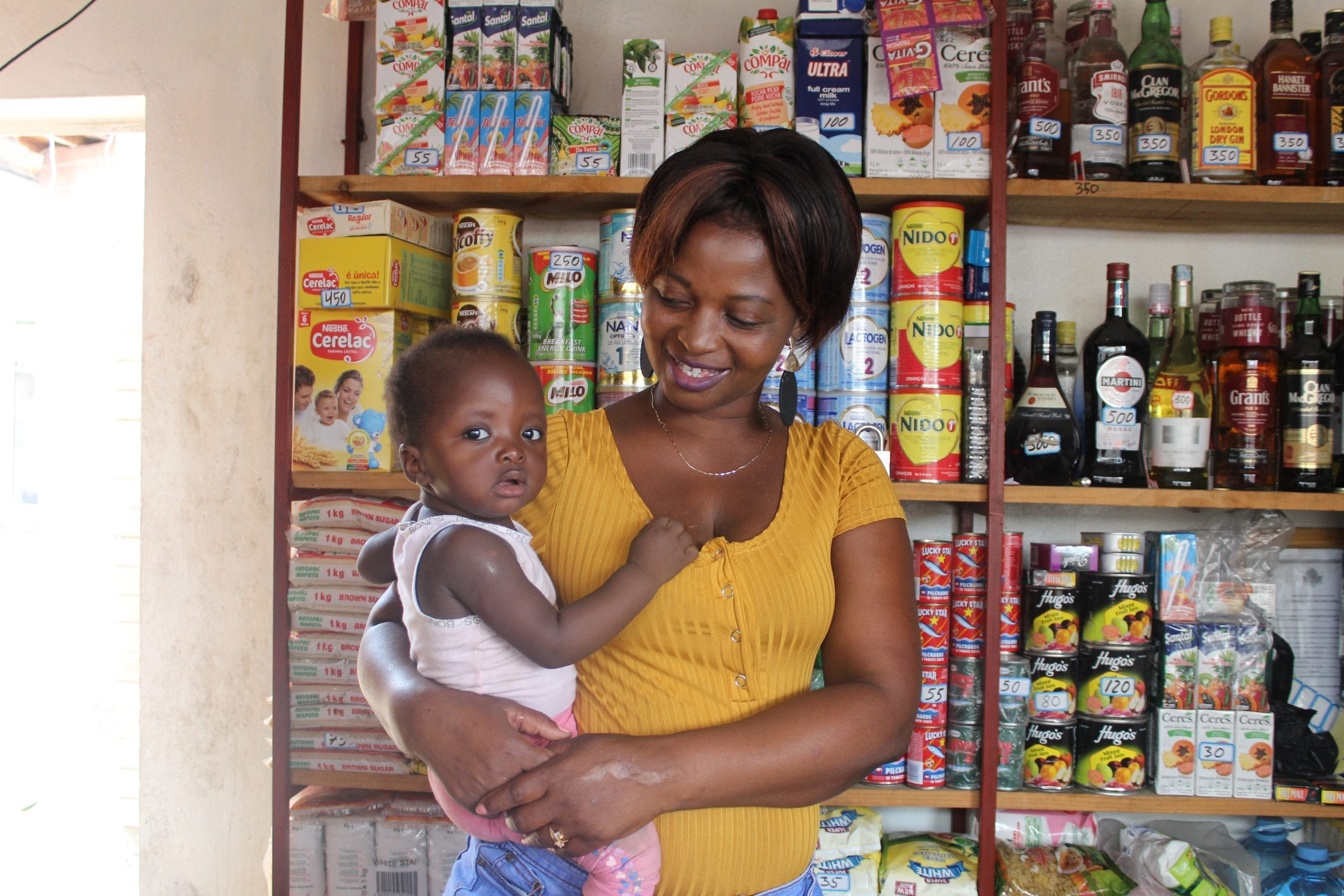 Many women leaders in developing countries are also mothers, like Bernadette Sambo who owns a small grocery store near Maputo, Mozambique.