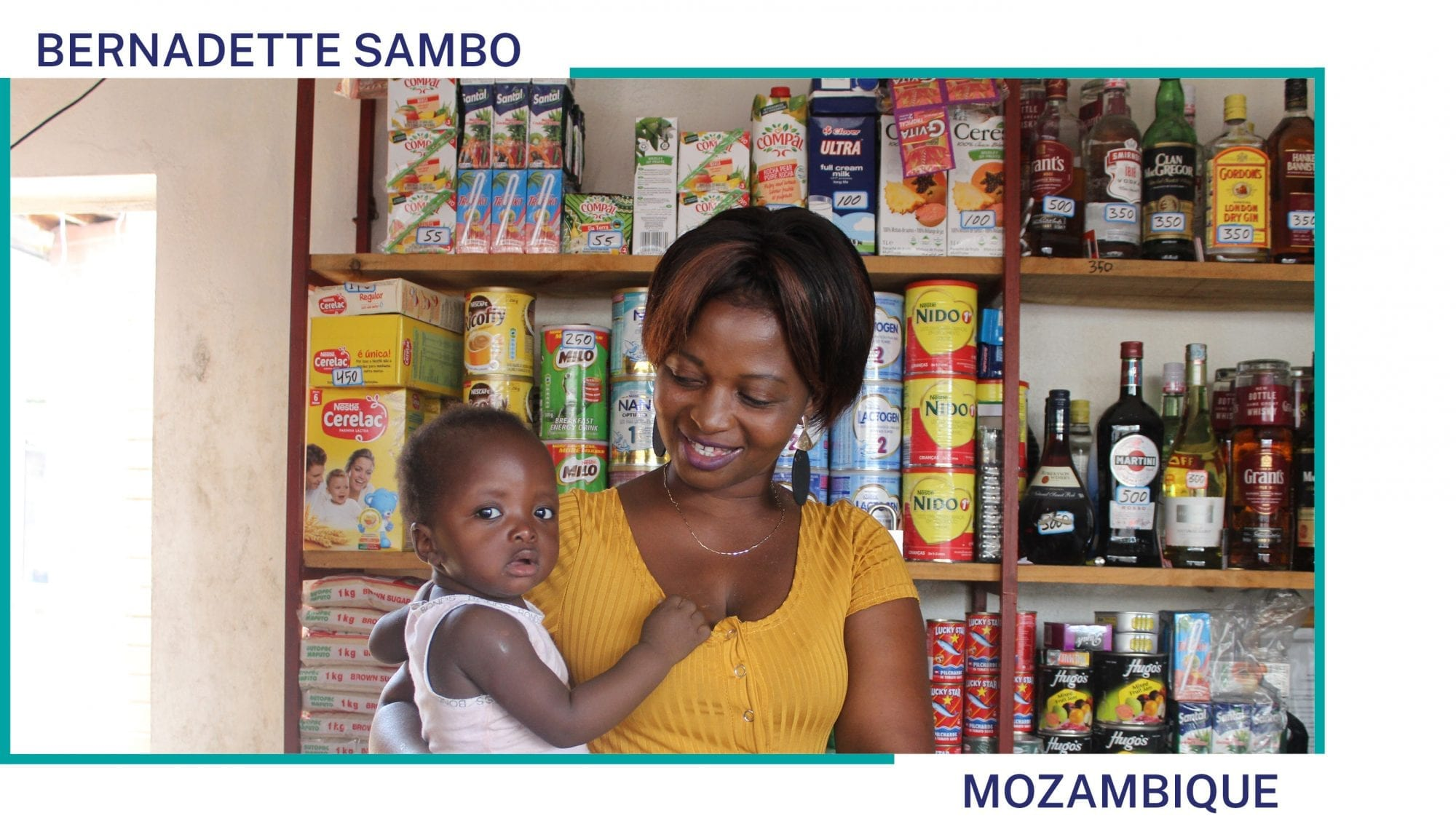 Bernadette Sambo holds her child in her shop in Mozambique