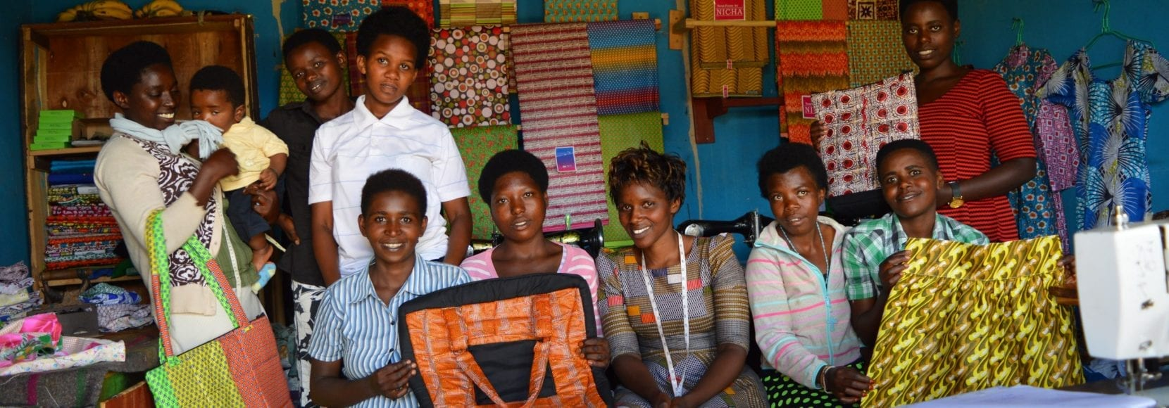Group of happy people sewing in East Africa