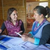 fighting poverty at TechnoServe looks like Two women smiling having a conversation in Chile