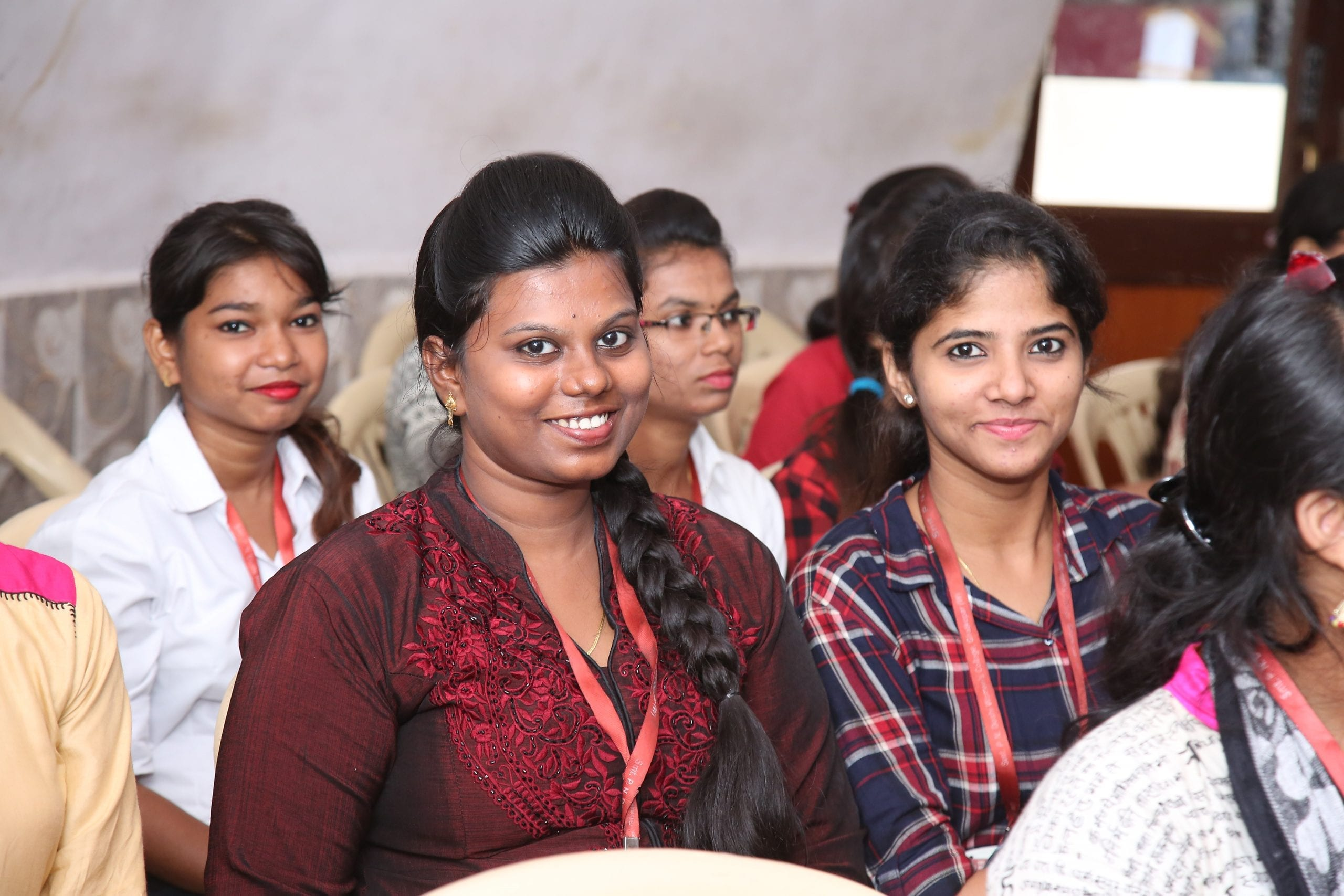 A group of young women learn about formal work opportunities at a workshop in India