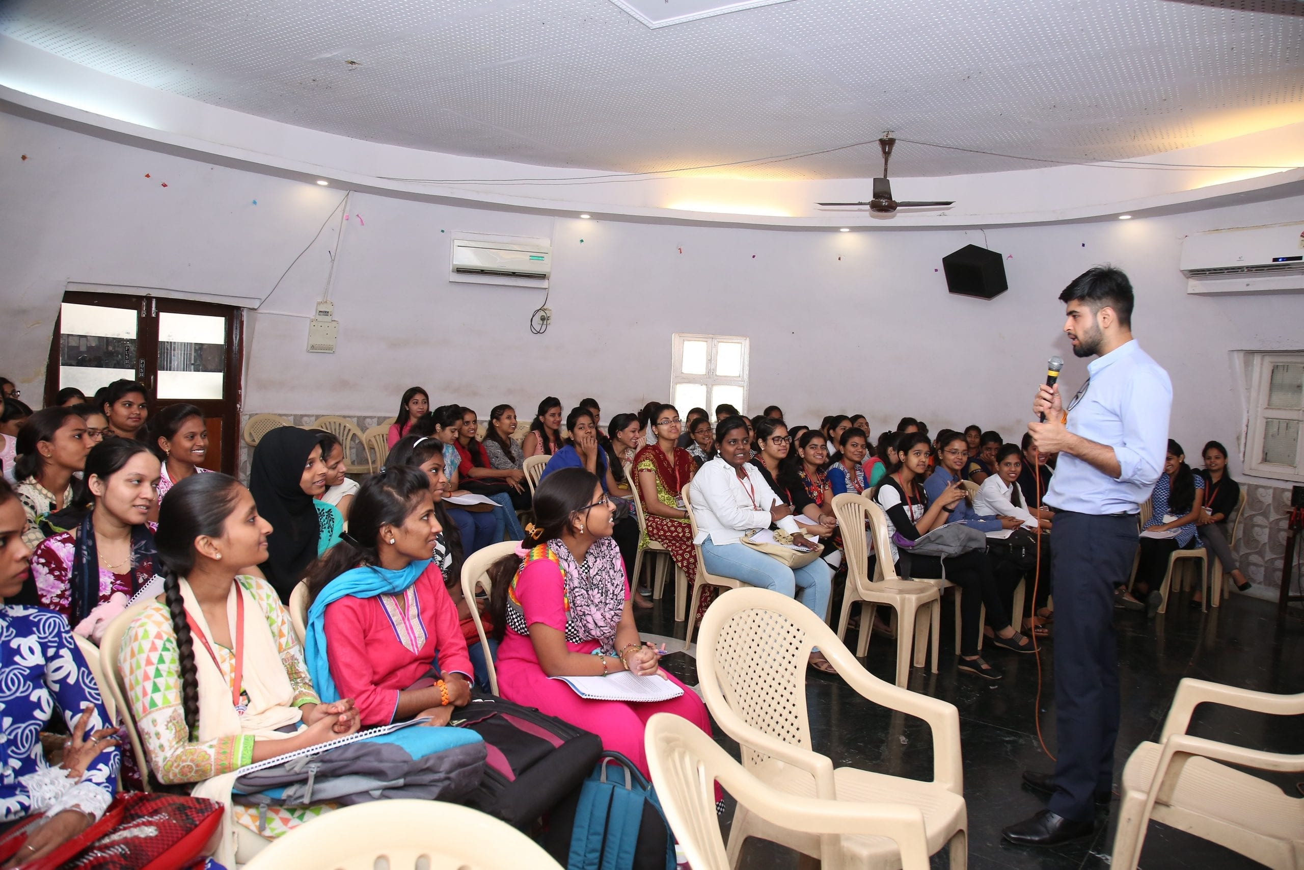 A group of young adults learning about formal work opportunities at a workshop in India
