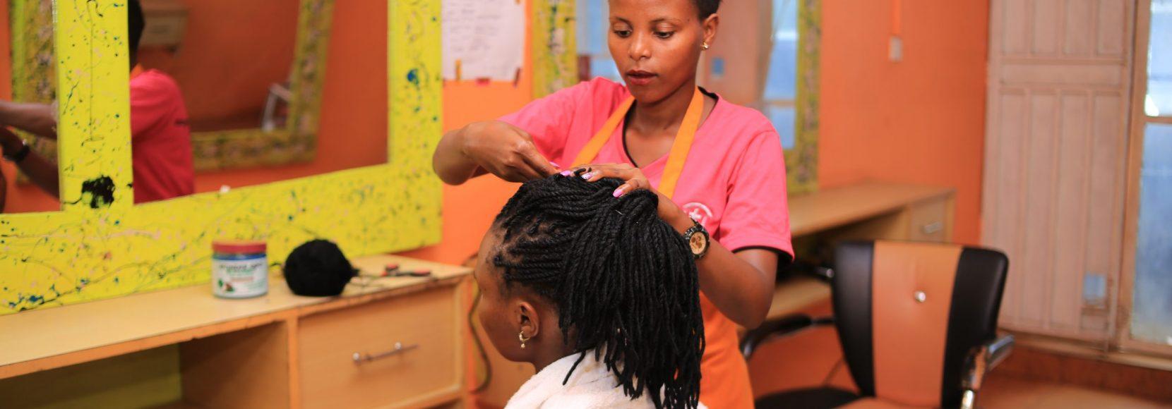 Carolyn works on a client in her salon business near Kampala, Uganda