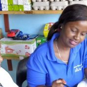 Two women business owners going through paperwork in Mozambique