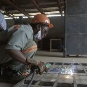 Moureen Nakisozi practices her welding skills outside of Kampala, Uganda