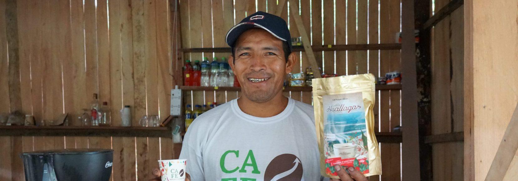 Cruz Juanan stands in his coffee shop in Peru
